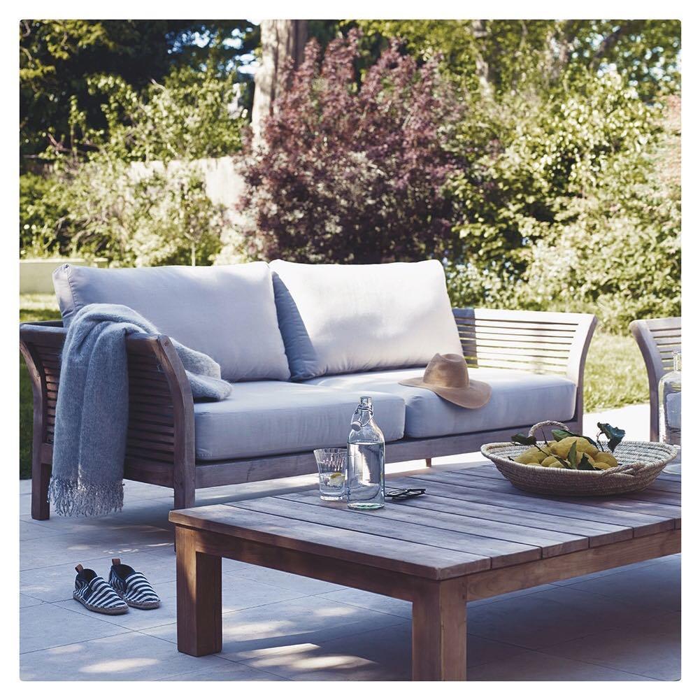 Raft reclaimed teak garden furniture on a summers day- reclaimed teak so good for furniture