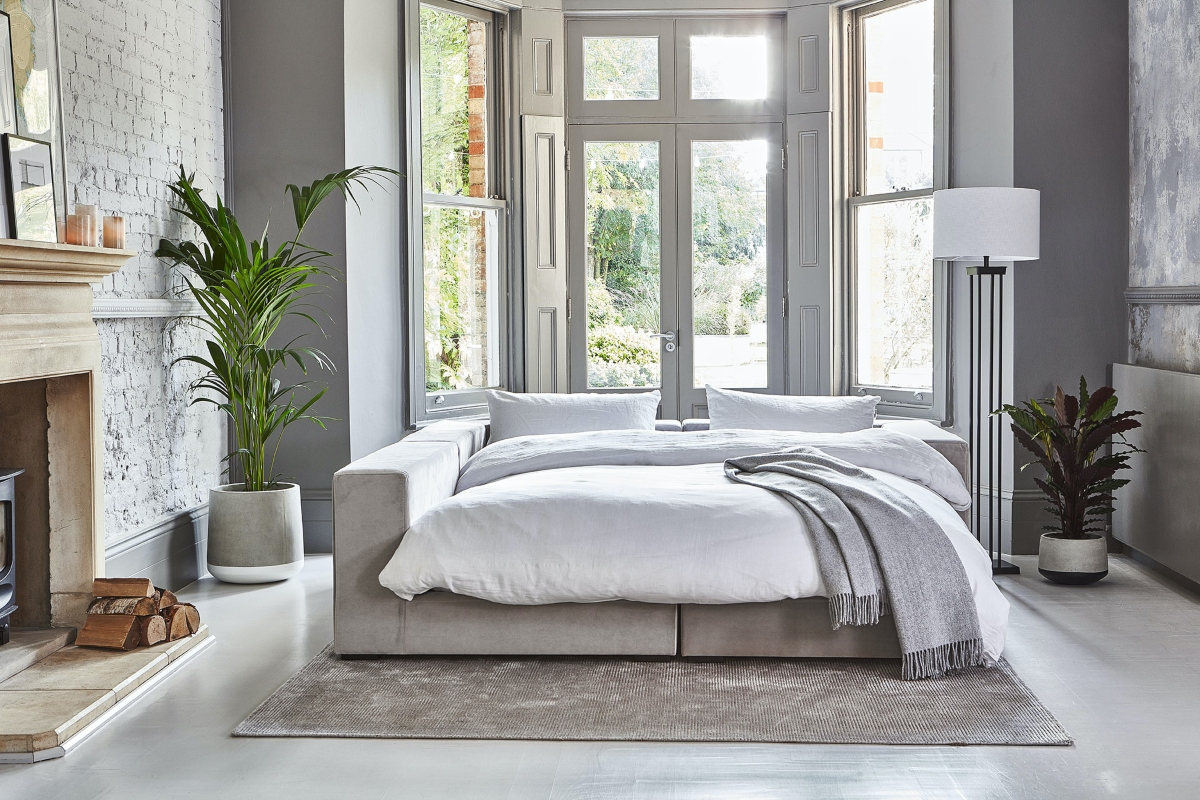 Sofa bed with indoor plant