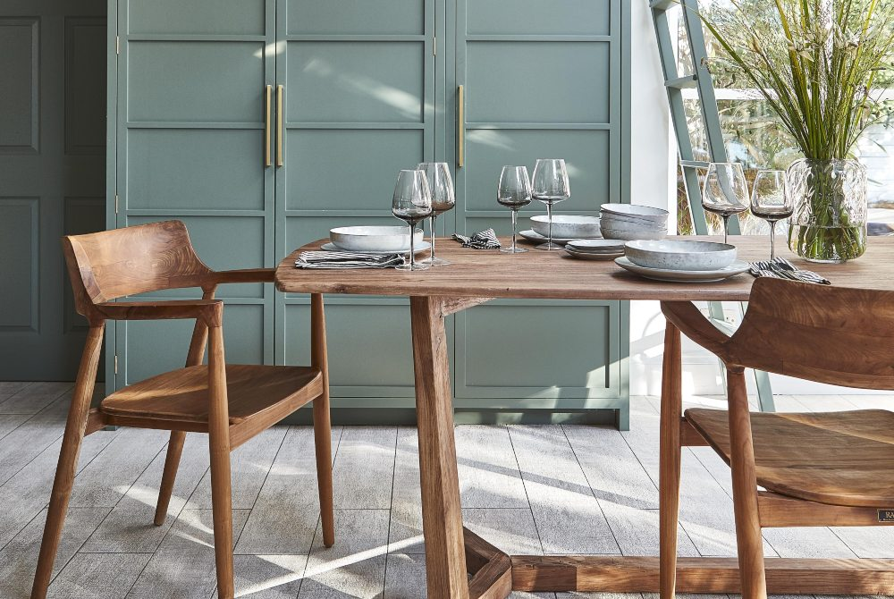 how to add colour to your home bisham dining table with green walls
