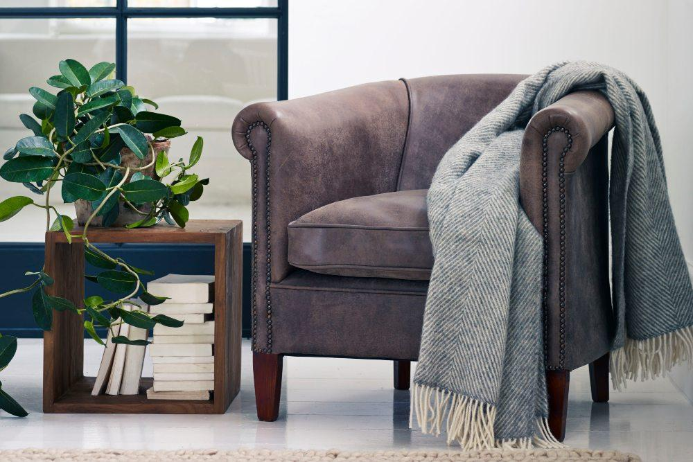 Self care with house plants, stylish storage cube and tub chair