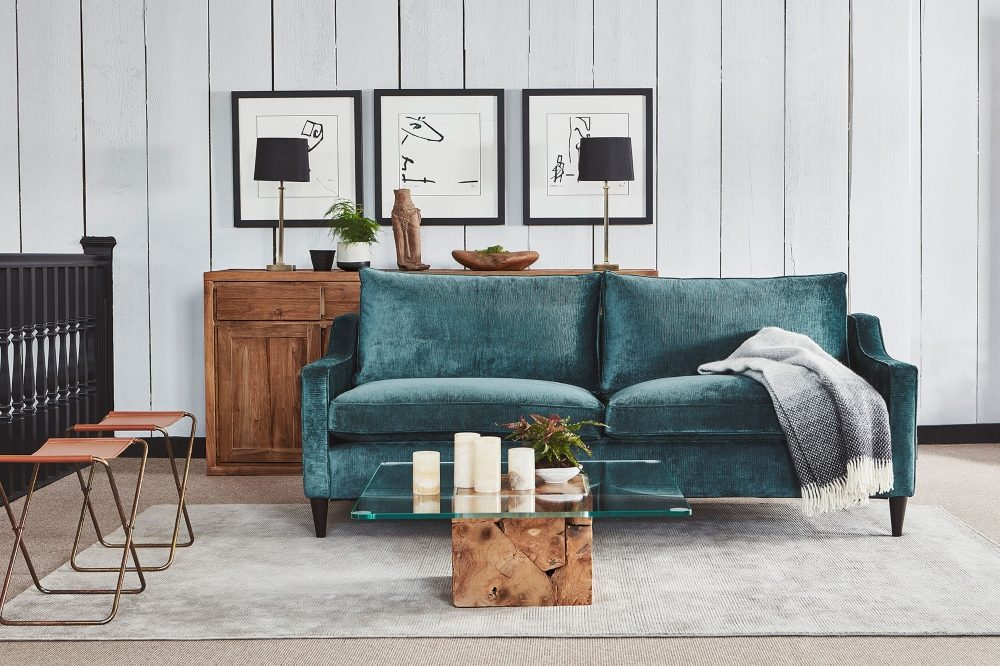 teak root glass coffee table with teal seattle sofa