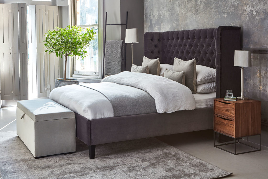 Montclair Bed upholstered bed Raft Furniture with fabric ottoman and teak bedside cabinet